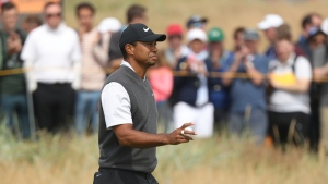 Tiger Woods of the US after putting on the 5th green during the third round of the British Open Golf Championship in Carnoustie, Scotland, Saturday July 21, 2018. (AP Photo/Peter Morrison)