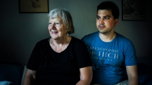 Elizabeth Hill poses for a portrait with her live-in student Julio Hernandez, in her home in Toronto, on Friday, July 20, 2018. THE CANADIAN PRESS/Christopher Katsarov