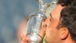 Francesco Molinari of Italy kisses the trophy after winning the British Open Golf Championship in Carnoustie, Scotland, Sunday July 22, 2018. (AP Photo/Jon Super)