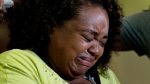 Duck boat accident survivor Tia Coleman breaks down during a news conference at Cox Medical Center Branson Saturday, July 21, 2018, in Branson, Mo. Coleman lost nine family members in the accident Thursday on Table Rock Lake which left over a dozen people dead. (AP Photo/Charlie Riedel)