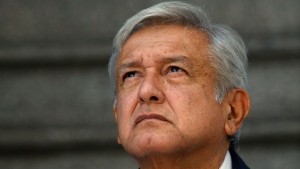 Mexico's President-elect Andres Manuel Lopez Obrador pauses as he meets with the press outside his party's headquarters in Mexico City, Sunday, July 22, 2018. (AP Photo/Marco Ugarte)