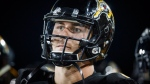 Hamilton Tiger-Cats quarterback Johnny Manziel looks on from the sidelines during second half CFL football action against the Saskatchewan Roughriders, in Hamilton, Ont., Thursday July 19, 2018. THE CANADIAN PRESS/Mark Blinch