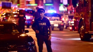 A police officer works the scene of a mass casualty incident in Toronto on Sunday, July 22, 2018. THE CANADIAN PRESS/Frank Gunn