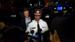 Toronto mayor John Tory and police chief Mark Saunders speaks to press following a mass casualty event in Toronto on Monday, July 23, 2018. THE CANADIAN PRESS/Christopher Katsarov