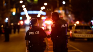 Police work at the scene of a mass casualty incident in Toronto on Sunday, July 22, 2018. THE CANADIAN PRESS/Nathan Denette