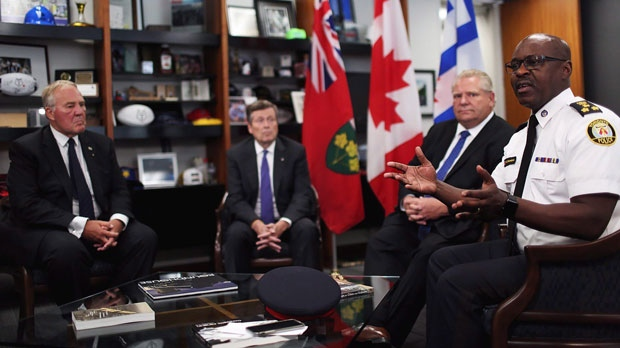 Minister of Border Security and Organized Crime Reduction Bill Blair, from left to right, Toronto mayor John Tory and Ontario Premier Doug Ford look on as police chief Mark Saunders speaks during an intergovernmental meeting in the wake of a mass shooting which happened in Toronto Sunday night, at Toronto City Hall on Monday, July 23, 2018. (THE CANADIAN PRESS/Nick Kozak)