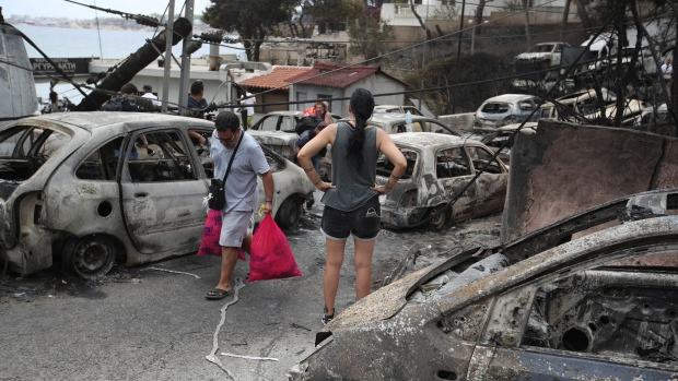 At least 50 dead as forest fires rage in Greece