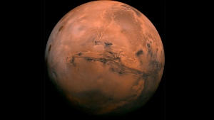 This image made available by NASA shows the planet Mars. This composite photo was created from over 100 images of Mars taken by Viking Orbiters in the 1970s.  (NASA via AP)