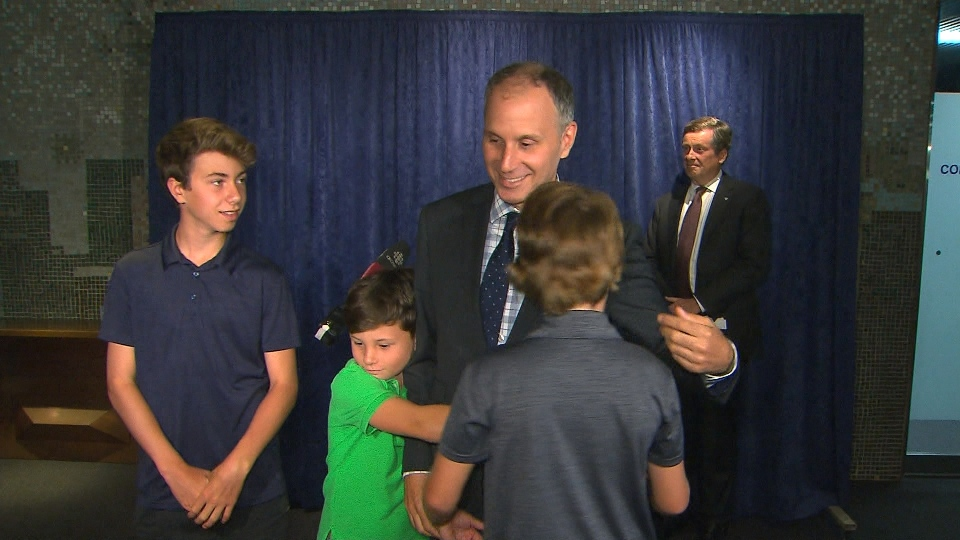 TTC Chair Josh Colle greets his children after announcing that he will not seek reelection in the fall.