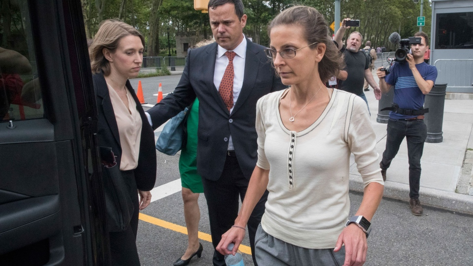 Clare Bronfman leaves federal court with her attorney Susan Necheles, Wednesday, July 25, 2018, in the Brooklyn borough of New York. (AP Photo/Mary Altaffer)