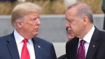 U.S. President Donald Trump, left, talks to Turkish President Recep Tayyip Erdogan, right, as they tour the new NATO headquarters in Brussels, Belgium, Wednesday, July 11, 2018. (Presidency Press Service via AP, Pool)