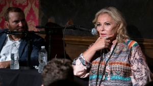 Roseanne Barr takes part in a special event and podcast taping with Rabbi Shmuley Boteach, left, at Stand Up NY, Thursday, July 26, 2018, in New York. (AP Photo/Craig Ruttle)