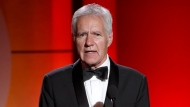FILE - In this April 30, 2017, file photo, Alex Trebek speaks at the 44th annual Daytime Emmy Awards at the Pasadena Civic Center in Pasadena, Calif.  (Photo by Chris Pizzello/Invision/AP, File)