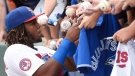 Buffalo Bisons third baseman Vladimir Guerrero Jr. (27) signs autographs before the start of triple-A baseball action against the Lehigh Valley IronPigs in Buffalo on Tuesday, July 31, 2018. Guerrero Jr. is making his triple-A debut after dominating double-A over 61 games. THE CANADIAN PRESS/Nathan Denette