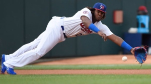 Buffalo Bisons third baseman Vladimir Guerrero Jr. (27) dives for the ball but can't make the catch on a single by Lehigh Valley IronPigs right fielder Aaron Altherr during first inning triple-A baseball action in Buffalo on Tuesday, July 31, 2018. THE CANADIAN PRESS/Nathan Denette