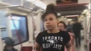 A suspect in a robbery aboard a TTC train on July 28 is shown in a screengrab image. (YouTube)