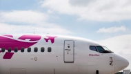 Swoop Airlines Boeing 737 on display during their media event, Tuesday, June 19, 2018 at John C. Munro International Airport in Hamilton, Ont. THE CANADIAN PRESS/Tara Walton