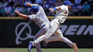 Seattle Mariners second baseman Andrew Romine, right, tags Toronto Blue Jays' Aledmys Diaz (1) on the fly as Diaz heads to first base before throwing to first base to complete the double play on Luke Maile in the second inning of a baseball game Sunday, Aug. 5, 2018, in Seattle. (AP Photo/Elaine Thompson)