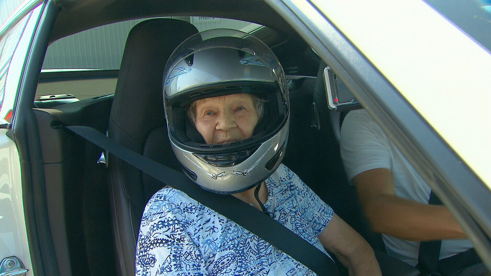 Maire Hollo is seen on the racetrack celebrating her 90th birthday.