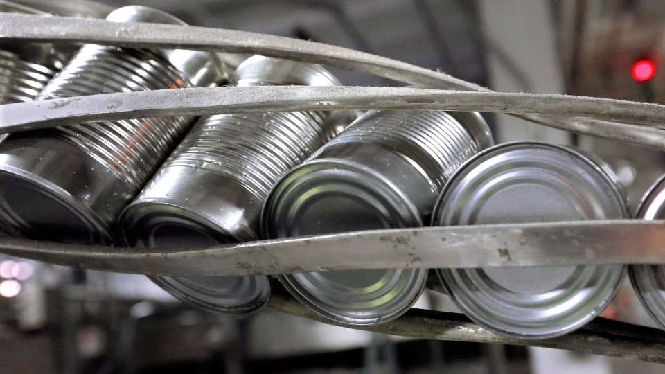 Canned processed pumpkins move along a conveyor belt in the case and label area of a cannery in Morton, Ill. THE CANADIAN PRESS/AP, Seth Perlman