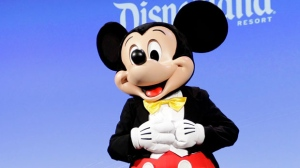 In this Jan. 4, 2017 file photo, the Disney character Mickey Mouse appears at CES International in Las Vegas. (AP Photo/Jae C. Hong, File)