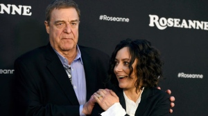 "John Goodman, left, and Sara Gilbert arrive at the Los Angeles premiere of ""Roseanne"" on Friday, March 23, 2018, in Burbank, Calif. TV plans to air the upcoming ""Roseanne"" spinoff, ""The Conners.""The Canadian broadcaster says the new ABC family comedy will premiere Oct. 16, the same day it premieres in the U.S.THE CANADIAN PRESS/AP-Invision/AP"