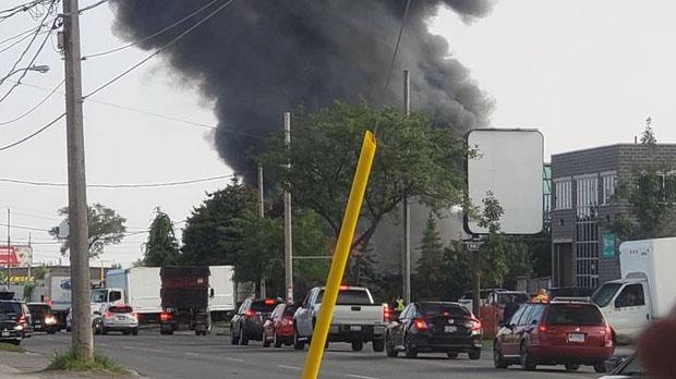 Heavy black smoke is seen coming from a fire in Etobicoke. (Twitter/@organic_pekitas)