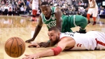 Toronto Raptors centre Jonas Valanciunas (17) and Boston Celtics guard Terry Rozier (12) eye a loose ball during second half NBA basketball action in Toronto on Wednesday, April 4, 2018. THE CANADIAN PRESS/Frank Gunn