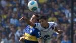 Boca Juniors' Pablo Ledesma, left, and Tigre's Lucas Janson, go for a header during an Argentina's league soccer match in Buenos Aires, Argentina, Sunday, Nov. 10, 2013. (AP Photo/Eduardo Di Baia)