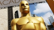 In this Feb. 21, 2015 file photo, an Oscar statue appears outside the Dolby Theatre for the 87th Academy Awards in Los Angeles. The Oscars are adding a new category to honor popular films and promising a brisk 3-hour ceremony on a much earlier air date of Feb. 9, 2020. (Photo by Matt Sayles/Invision/AP, File)