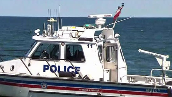 A boat with the Toronto police's marine unit is seen during a water rescue at Woodbine Beach.