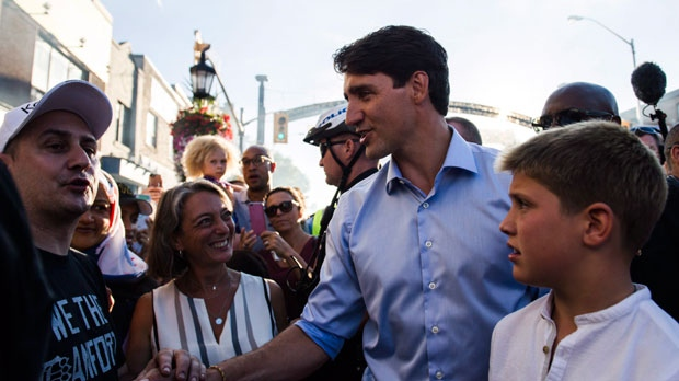 Prime Minister Justin Trudeau greets the crowd on the Danforth in Toronto, on Friday, August 10, 2018. THE CANADIAN PRESS/Christopher Katsarov