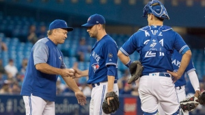 Toronto Blue Jays manager John Gibbons takes the ball from starting pitcher Marco Estrada in the sixth inning of their American League MLB baseball game against the Tampa Bay Rays, in Toronto on Friday, August 10, 2018. THE CANADIAN PRESS/Fred Thornhill