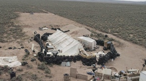 This aerial image shows a remote outpost near Amalia, N.M on Thursday, Aug. 9, 2018. Three siblings and two other adults have been charged with child abuse stemming from the alleged neglect of 11 children found living on the squalid compound. (Karl Brennan/DroneBase via AP)