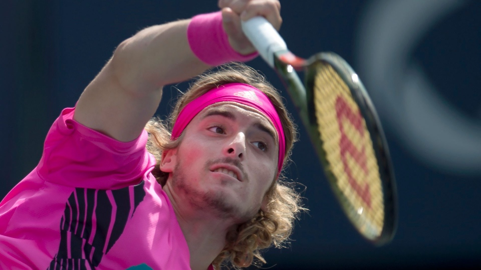 Stefanos Tsitsipas of Greece serves to Kevin Anderson of South Africa during Rogers Cup semifinal tennis tournament action in Toronto on Saturday August 11, 2018. THE CANADIAN PRESS/Frank Gunn