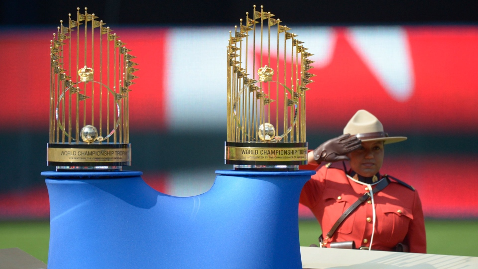 The 1992 and 1993 World Series trophies are on display during a pre-game presentation celebrating the 25th anniversary of the Toronto Blue Jays' back-to-back championships before the game against the Tampa Bay Rays at Rogers Centre Saturday August 11, 2018 in Toronto. THE CANADIAN PRESS/Jon Blacker