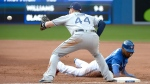 Toronto Blue Jays' Teoscar Hernandez, right, dives safely back into first base ahead of a tag by Tampa Bay Rays' C.J. Cron during the sixth inning of MLB baseball action in Toronto on Saturday, August 11, 2018. THE CANADIAN PRESS/Jon Blacker