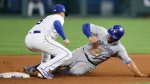 Toronto Blue Jays' Randal Grichuk, right, is tagged out attempting to steal second base by Kansas City Royals second baseman Whit Merrifield in the fourth inning of a baseball game at Kauffman Stadium in Kansas City, Mo., Monday, Aug. 13, 2018. (AP Photo/Colin E. Braley)