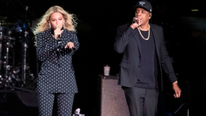 In this Nov. 4, 2016 file photo, Beyonce and Jay-Z perform during a Democratic presidential candidate Hillary Clinton campaign rally in Cleveland. During a performance on Monday, Aug. 13, 2018, Beyonce dedicated her performance with husband, Jay Z, to the Queen of Soul drawing a thunderous roar from Aretha Franklin's hometown of Detroit. ( AP Photo/Matt Rourke, File)