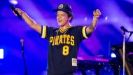 """In this May 27, 2018 file photo, Bruno Mars performs at the Bottle Rock Napa Valley Music Festival at Napa Valley Expo in Napa, Calif. Cardi B may have backed out of the Bruno Mars tour, but he's found four other acts to hit the road with him. Mars announced Tuesday, Aug. 14, 2018, that Boyz II Men, Charlie Wilson, Ciara and """"Boo'd Up"""" singer Ella Mai will perform during his upcoming fall concerts on his 24K Magic World Tour. (Photo by Amy Harris/Invision/AP, File)"""