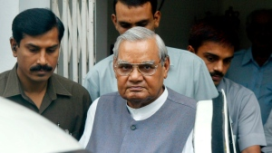FILE- In this Aug. 23, 2004 file photo, senior Bharatiya Janta Party (BJP) leader Atal Bihari Vajpayee, center, leaves after a meeting at the party headquarters in New Delhi, India. India's top leaders and politicians are visiting the New Delhi hospital where doctors say Vajpayee is in critical condition after a prolonged illness. (AP Photo/Sebastian John, File)