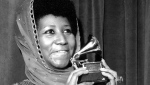 "FILE - In this March 3, 1975 file photo, singer Aretha Franklin poses with her Grammy Award for for best female R&B vocal performance for ""Ain't Nothing Like the Real Thing"" at the 17th Annual Grammy Award presentation in New York. A person close to Franklin said on Monday that the 76-year-old singer is ill. Franklin canceled planned concerts earlier this year after she was ordered by her doctor to stay off the road and rest up. (AP Photo, File)"