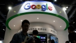 FILE - In this April 28, 2016, file photo, visitors gather at a display booth for Google at the 2016 Global Mobile Internet Conference (GMIC) in Beijing. (AP Photo/Andy Wong, File)