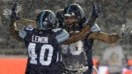 Toronto Argonauts defensive lineman Cleyon Laing (90) celebrates a quarterback sack with defensive lineman Shawn Lemon (40) during first half CFL football action against the Calgary Stampeders in the 105th Grey Cup Sunday November 26, 2017 in Ottawa. THE CANADIAN PRESS/Ryan Remiorz