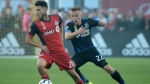 Toronto FC's Jonathan Osorio, left, works the ball around San Jose Earthquakes' Tommy Thompson during second half MLS soccer action in Toronto on Saturday, September 9, 2017. THE CANADIAN PRESS/Jon Blacker