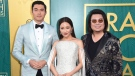 "Henry Golding, from left, Constance Wu and executive producer/author Kevin Kwon arrive at the premiere of ""Crazy Rich Asians"" at the TCL Chinese Theatre on Tuesday, Aug. 7, 2018, in Los Angeles. The first time ""Crazy Rich Asians"" author Kevin Kwan realized the magnitude of his lavish Singapore-set story, he was in Canada. THE CANADIAN PRESS/AP, Richard Shotwell/Invision"