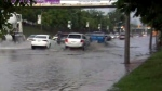 Cars moving through flooding in the city is seen after heavy rain rolled through on Friday afternoon.
