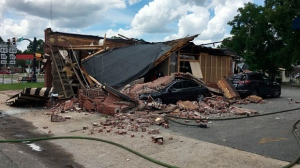 This photo provided by the Georgia Insurance and Safety Fire Commissioner's Office shows a destroyed coffee shop after an explosion and fire in Homerville, Ga., Friday, Aug. 17, 2018. The explosion and fire destroyed the coffee shop Friday in this rural south Georgia city, injuring a few workers and prompting a warning from city officials for residents to avoid the downtown area. (Georgia Insurance and Safety Fire Commissioner's Office via AP)