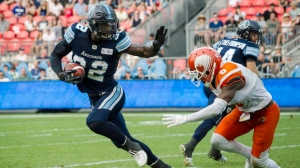 Toronto Argonauts running back James Wilder Jr. (32) runs with the ball during fourth quarter CFL action against the B.C. Lions in Toronto on Saturday, August, 18, 2018. THE CANADIAN PRESS/Christopher Katsarov