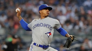 Toronto Blue Jays' Marcus Stroman delivers a pitch during the first inning of a baseball game against the New York Yankees, Friday, Aug. 17, 2018, in New York. (AP Photo/Frank Franklin II)